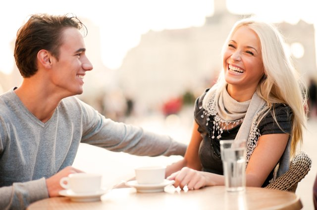 Cheerful couple enjoying in the sidewalk cafe.   [url=http://www.istockphoto.com/search/lightbox/9786786][img]http://dl.dropbox.com/u/40117171/couples.jpg[/img][/url]