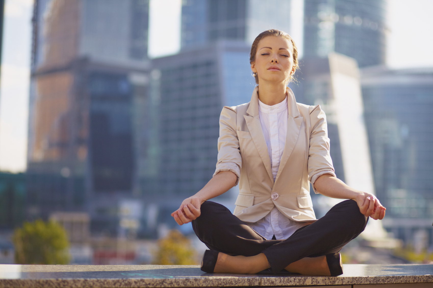 Business woman meditating outdoor over building background  [url=http://www.istockphoto.com/search/lightbox/14406610 t=_blank][img]http://azarubaika.com/iStockphoto/2012_08_26_Victoria_Business_Yoga.jpg[/img][/url]  [url=http://www.istockphoto.com/search/lightbox/14296572 t=_blank][img]http://azarubaika.com/iStockphoto/ModelVictoria.jpg[/img][/url]